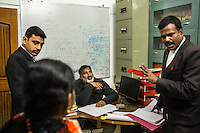 Ajeet Singh plays the Judge as the Guria lawyers try trick questions on Brinda (center) during a mock trial with the legal team in preparation for her final witness court appearance in the Guria office in Varanasi, Uttar Pradesh, India on 23 November 2013. She is one of the 57 underaged and trafficked girls rescued from the Shivdaspur red light area in Varanasi, who has been fighting a court case against her traffickers and brothel owners for the past 8 years.