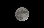 Close up view of the full moon on a clear night.