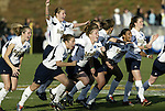05 December 2004: Notre Dame players rush their goalkeeper after her save won the championship. Notre Dame defeated UCLA 4-3 on penalty kicks after the game ended in a 1-1 overtime tie at SAS Stadium in Cary, NC in the championship match in the 2004 NCAA Division I Women's College Cup..