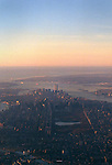 The island of Manhattan and NY Harbor as seen from a commercial airliner  just after take-off at 7am.