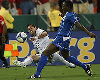 Santino Quaranta #20 of the USA slides the ball past Osman Chavez #2 of Honduras during a CONCACAF Gold Cup match at RFK Stadium on July 8 2009 in Washington D.C.