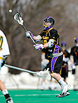 10 April 2011: University at Albany Great Dane midfielder Jack Reynolds, a Junior from Farmingdale, NY, in action against the University of Vermont Catamounts on Moulton Winder Field in Burlington, Vermont. The Catamounts defeated the visiting Danes 11-6 in America East play. Mandatory Credit: Ed Wolfstein Photo