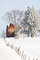 Hoarfrost covers the trees on a rural Minnesota farm scene in winter.