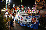 Palestinians walk next to a model of a ship during a rally in solidarity with activists aboard a flotilla of boats who are soon to set sail for Gaza in a fresh bid to break Israel's blockade of the territory, in the West Bank city of Ramallah on June 29, 2015. Israeli navy boarded and seized a vessel taking part in a flotilla set to reach the Gaza Strip early Monday, the Israel Defense Forces (IDF) announced in a statement. Photo by Shadi Hatem