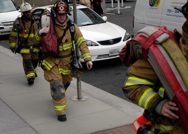 Firefighters respond to a fire in the Ronlad Reagan building in downtown Washington, DC.