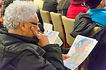 January 3, 2013 - Mineola, New York, U.S. - The Nassau County Districting Advisory Commission holds a night time meeting on two Redistricting maps for the 19 Legislative Districts, one proposed by Republicans, one by Democrats. In the standing room only chambers, dozens shared their views with the commission during the Public Comment segment. Audience members studied the two maps, which did not include street names. After a brief recess, the commission voted at 10:40 PM for each map, neither of which passed. By January 5 it must complete its work for the Nassau Legislature, which must pass a Redistricting map by March 5, 2013.