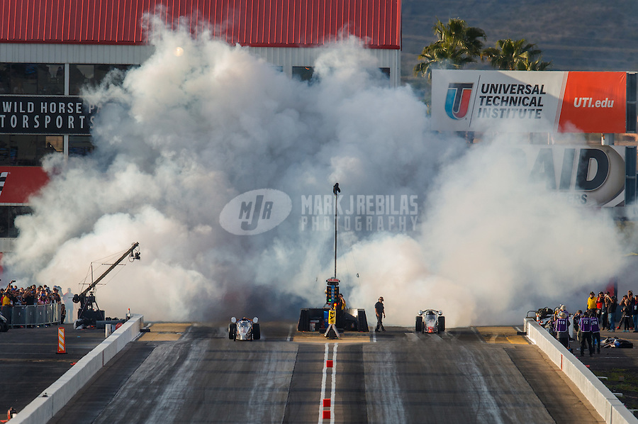Feb 25, 2017; Chandler, AZ, USA; Smoke fills the air as a pair of NHRA jet dragsters race to close out qualifying for the Arizona Nationals at Wild Horse Pass Motorsports Park. Mandatory Credit: Mark J. Rebilas-USA TODAY Sports