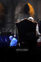 Pope Francis holds the wooden cross during the Via Crucis (Way of the Cross) torchlight procession on Good Friday in front of the Colosseum in Rome. .April 4, 2015