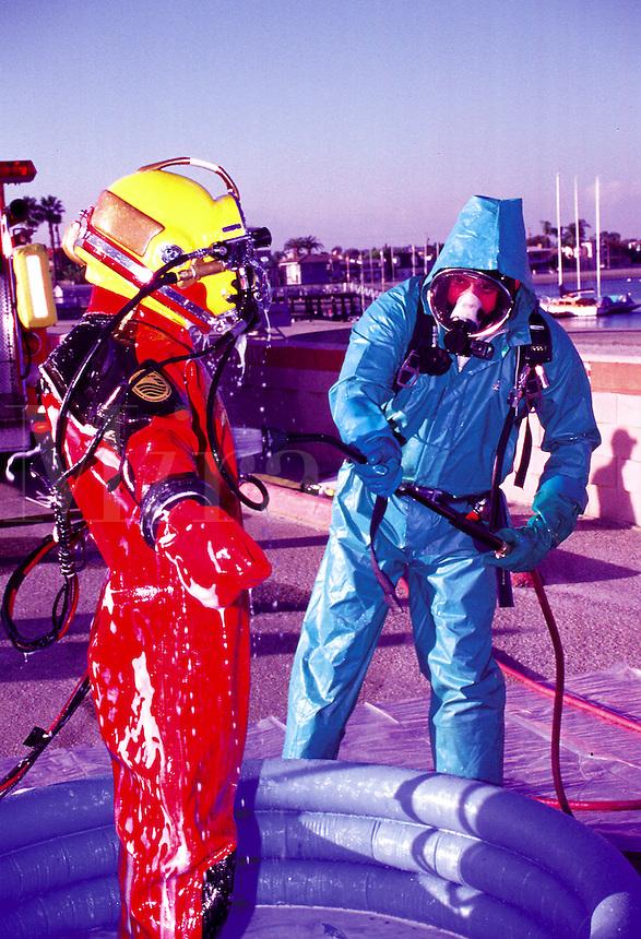 Decontamination of rescue diver by hazmat team, Long  Beach, California.