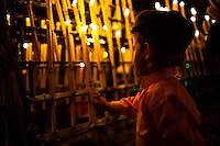 A child leaves a candle to represent of loved ones who can no longer celebrate the pilgrimage as did their parents and grandparents. The traditions are extremely important in the region, giving the possibility to be preserved in time.