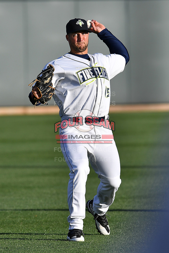 Left fielder Tim Tebow (15) of the Columbia Fireflies warms up before his first Class A game against the Augusta GreenJackets on Opening Day, Thursday, April 6, 2017, at Spirit Communications Park in Columbia, South Carolina. (Tom Priddy/Four Seam Images)