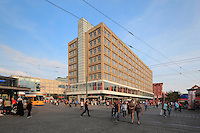 The Berolinahaus, built 1929-32 by Peter Behrens, used for retail and offices, on the Alexanderplatz, with people and tramlines, Berlin, Germany. This classical modernist building has been protected since 1975 as an example of the Neuen Sachlichkeit or New Objectivity style. Picture by Manuel Cohen
