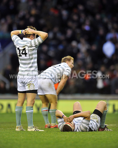 Cambridge players appear dejected at the final whistle. The Varsity Match between Oxford University and Cambridge University on December 6, 2012 at Twickenham Stadium in London, England. Photo by: Patrick Khachfe / Onside Images