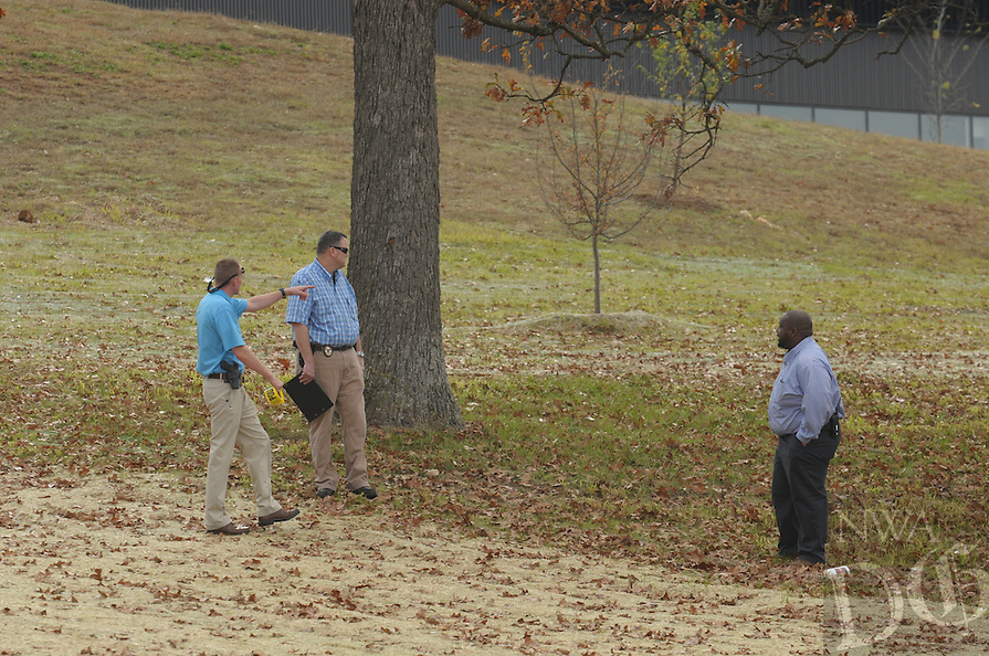 NWA Democrat-Gazette/ANDY SHUPE<br /> Representatives from area law enforcement collect information Tuesday, Nov. 3, 2015, near Fayetteville High School after a single-engine plane crashed on Martin Luther King Jr. Boulevard in Fayetteville.