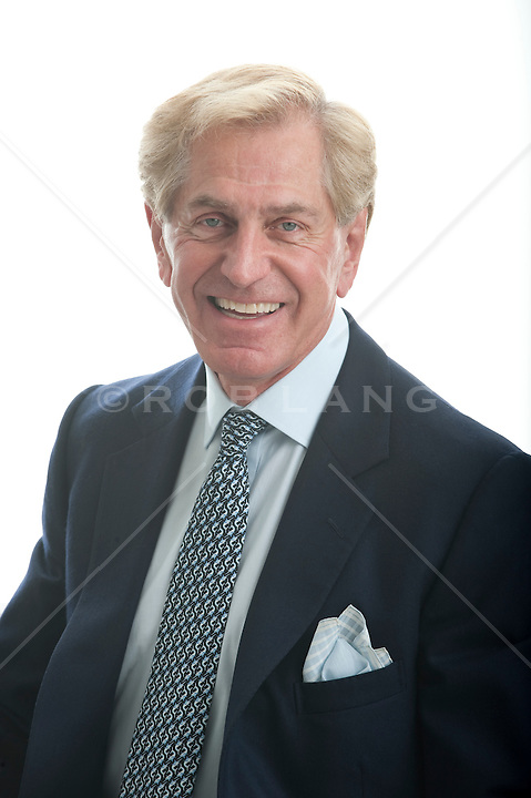Mature man in a business suit smiling and looking at camera