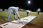 Todd Horton, the athletic director, and head football coach help paint the lines on the field on Thursday, Oct. 10, 2013. A group of former students and assistant coaches gather to cook out and  help paint the field the day before a football game. <br /> Photo by Coty Giannelli