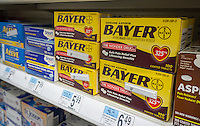 Containers of Bayer aspirin on a drugstore shelf in New York on Monday, May 23, 2016. Bayer AG, the German pharmaceutical and chemical company, has made an offer to buy the Monsanto Co. for $62 billion. The combined companies would be the largest agrochemical business in the world.  (© Richard B. Levine)