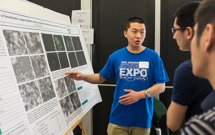 Ru Jia, a PhD student in Chemical Engineering, explains his research on corrosion of carbon steel by bacterial growth to visitors at the Ohio University Student Expo on Thursday, April 10, 2015.  Photo by Ohio University /  Rob Hardin