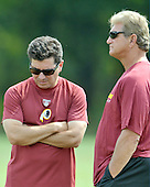 Ashburn, VA - August 6, 2009 -- Owner Daniel Snyder, left, and former quarterback Joe Theismann, right, discuss the team during the 2009 Washington Redskins Training Camp at Redskins Park in Ashburn, Virginia on Thursday, August 6, 2009..Credit: Ron Sachs / CNP
