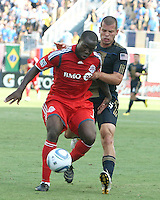 Alejandro Moreno #15 of the Philadelphia Union pulls on Nana Attakora #3 of Toronto FC during an MLS match at PPL stadium in Chester, PA. on July 17 2010. Union won 2-1 with a last minute penalty kick goal.