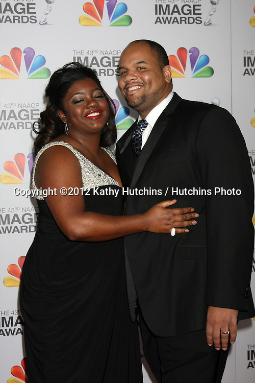 LOS ANGELES - FEB 17:  Julia Pace Mitchell, Stephen L. Hightower II arrives at the 43rd NAACP Image Awards at the Shrine Auditorium on February 17, 2012 in Los Angeles, CA