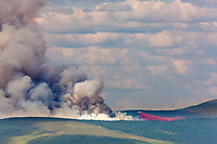 P3 plane drops retardant to suppress the growth of the Hastings forest fire north of Fairbanks, which increased its reach beyond 12,000 acres on June 7, 2011.