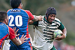 Foi Lokotui fends off Jon-Paul Fonoimoana. Counties Manukau Premier Club Rugby game between Manurewa and Ardmore Marist played at Mountfort Park, Manurewa on Saturday June 19th 2010..Manurewa won the game 27 - 10 after leading 15 - 5 at halftime.