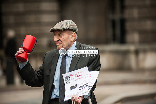 A pensioner selling copies of The Greater London Pensioner.