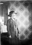 FRANCES HILL. In the same interior seen in image LB003, Frances Hill is dressed for going out. Knowing that she went all the way to New York City (and soon died there) makes this image poignant.<br /> <br /> The 1920 census shows Aaron Douglas, 21 year old University student, was a roomer in the household of Ben. F. &amp; Lottie Corneal. Ben was head of the waiters club of Lincoln; a second roomer was a barber. They resided at 524 N. 9th--a couple of blocks south of Mamie Griffin's house at 915 U. The Corneals next door neighbors were John and Mable Galbreath at 524 N. 9th. John was sometimes a waiter; in 1920 he was listed as operating a restaurant. John and Mable also had a roomer, as well as a stepdaughter--15 year old Frances Hill. <br /> <br /> Photographs taken on black and white glass negatives by African American photographer(s) John Johnson and Earl McWilliams from 1910 to 1925 in Lincoln, Nebraska. Douglas Keister has 280 5x7 glass negatives taken by these photographers. Larger scans available on request.