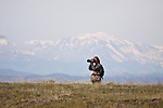 Photography in Wyoming sagebrush, USA with Rocky Mountains in background