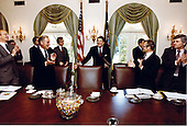 United States President Ronald Reagan attends his first cabinet meeting after the assassination attempt as Al Haig, James Watt, and Frank Carlucci applaud in the Cabinet Room in the White House in Washington, D.C. on Friday, April 24, 1981..Mandatory Credit: Michael Evans - White House via CNP