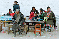 A tibetan family from the Amdo country is waiting for the beginning of the ceremony of the afternoon during the first day of Monlam Chenmo (the Great Prayer) in the monastery of Labrang. Xiahe, Gansu, China, February 22, 2007.