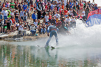 """Cushing Classic at Squaw Valley 18"" - Photograph of a skier crossing a pond during the Cushing Classic at Squaw Valley, USA."