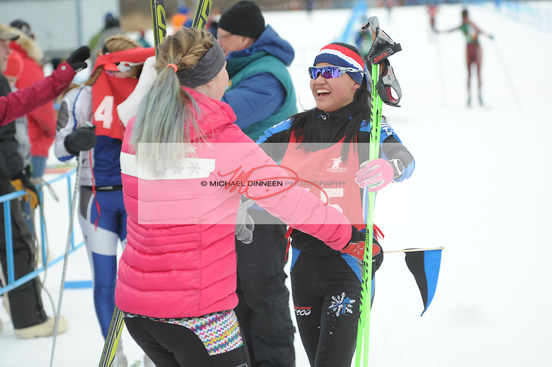 Chugiak's Oda Fossum accepts a hug from teammate Heidi Booher after Fossum's relay effort helped the Chugiak girls take second place at the Region IV ski championships Saturday, Februrary 20, 2016. Photo for the Star by Michael Dinneen