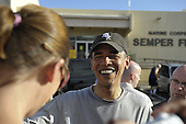 """Kailua, Hawaii - December 24, 2008 -- United States President-elect Barack Obama greets well wishers after working out at the gym at Marine Corps Base Hawaii at Kaneohe Bay in Kailua, Hawaii on Wednesday, December 24, 2008..Obama wished them """"Mele Kalikimaka"""" which is Hawaiian for """"Merry Christmas""""..Credit: Joaquin Siopack / Pool via CNP"""