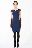 Model wears a cross wrap sheath dress by Fiona Cibani, for the Ports 1961 Pre-Fall 2011 L'heure bleue collection, December 8, 2010.