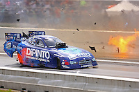 Jun 4, 2016; Epping , NH, USA; Flmes and debris are visible alongside the car of NHRA funny car driver John Hale as competitor Jack Beckman (not pictured) explodes an engine during qualifying for the New England Nationals at New England Dragway. Mandatory Credit: Mark J. Rebilas-USA TODAY Sports