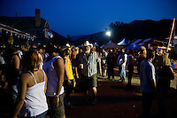 People gather outside at the Testicle Festival at the Rock Creek Lodge in Clinton, MT.  The Rock Creek Lodge in Clinton, MT, has hosted the annual Testicle Festival since the early 1980s.  The four day festival and party revolves around the consumption of so-called Rocky Mountain Oysters, which are deep-fried bull testicles.