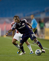 New England Revolution midfielder Sainey Nyassi (14) controls the ball at midfield. Chivas USA defeated the New England Revolution, 4-0, at Gillette Stadium on May 5, 2010.