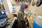 Ahlam Mazatha prepares food in her kitchen in Madaba, a sprawling Palestinian refugee camp in Jordan that has grown in recent years with the arrival of refugees--like Mazatha--from war-torn Syria. She and her husband and three children fled Daraa in 2013 when bombing destroyed their home. Mazatha was a teacher in Syria, and her husband was a librarian and owned a taxi, but in Jordan they are not allowed to work by the government. The  Department of Service for Palestinian Refugees of the Middle East Council of Churches, a member of the ACT Alliance, provides a variety of services here, including medical care.
