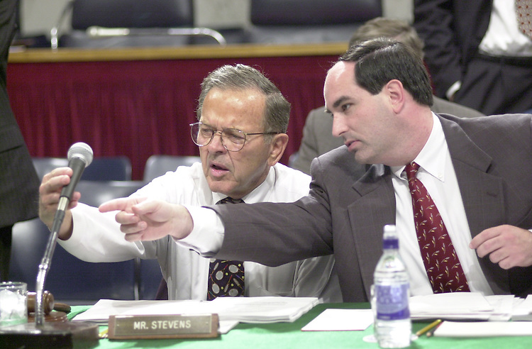 Stevens T.1(DG) 051800 -- Chairman Ted Stevens, R-Alaska, along with the help of his aid trys to turn off the microphone before the start of the Senate Appropriations Committee markup.