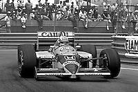 DETROIT, MI - JUNE 22: Nigel Mansell of Great Britain drives the Williams FW11/Honda RA166E during the Detroit Grand Prix FIA Formula One World Championship race on the Detroit Street Circuit in Detroit, Michigan, on June 22, 1986.
