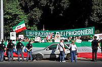 Roma 25  Luglio 2009.Global day of action .Manifestazione davanti all'Ambasciata dell'Iran per denunciare la violenza e le persecuzioni che si sono scatenate in Iran contro chi protestava per i risultati elettorali dello scorso 12 Giugno..Demonstration in front of Iran Embassy to denounce the violence and persecution that have been unleashed in Iran who protested against the election results of last June 12