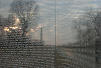 Morning sky and Washington Monument reflected on the Vietnam Veterans Memorial