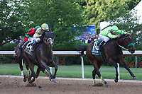HOT SPRINGS, AR - April 15: Classic Empire #2 and jockey Julien Leparoux break through the field to run down Conquest Mo Money #11 to win the Arkansas Derby at Oaklawn Park on April 15, 2017 in Hot Springs, AR. (Photo by Ciara Bowen/Eclipse Sportswire/Getty Images)