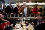 Sen. John McCain (R-AZ, center right)  and Sen. Joe Lieberman (I-CT, center left) greet diners at a campaign stop in Derry, N.H., on Wednesday, Jan. 2, 2008.