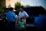 At left, officer Alberto Cortez Jr. speaks with a family that claims they were threatened by a subject claiming to be affiliated with the Mexican criminal organization &quot;Los Zetas&quot; after an argument on August 19, 2010 in Laredo, Texas. The officers at the scene said in recent months there has been an increase in similar claims.