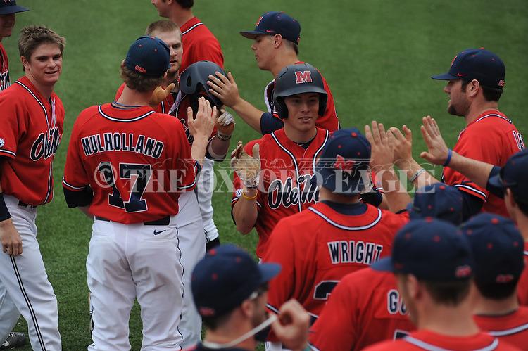 Ole Miss' Alex Yarbrough (2) hits a two run home run vs. Houston at Oxford-University Stadium in Oxford, Miss. on Sunday, March 11, 2012. Ole Miss won 11-3 to sweep the three-game series.