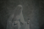Conceptual image of female in white ghostly gown