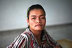 A girl who cannot hear or speak poses for a photograph at a center for children who have been affected by dioxin exposure in the village of Hoa Nhon, near Da Nang, Vietnam. The Da Nang Association of Victims of Agent Orange/Dioxin says that more than 1,400 children around the city suffer from mental and physical disabilities because of dioxin exposure, a legacy of the U.S. military's use of Agent Orange and other herbicides during the Vietnam War more than 40 years ago. About 60 children attend the Hoa Nhon center each day. Many of them have mental disabilities or they cannot hear or speak. Children are taught to read and write, sew clothes, make handicrafts and help their families raise crops and livestock. The Vietnam Red Cross estimates that 3 million Vietnamese suffer from illnesses related to dioxin exposure, including at least 150,000 people born with severe birth defects since the end of the war. The U.S. government is paying to clean up dioxin-contaminated soil at the Da Nang airport, which served as a major U.S. base during the conflict. But the U.S. government still denies that dioxin is to blame for widespread health problems in Vietnam and has never provided any money specifically to help the country's Agent Orange victims. May 29, 2012.